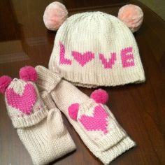 """""""LOVE"""" BEENIE AND MITTEN SET Super cute pink pompoms decorate the sweater knit hat and mittens. Mittens fold back to expose fingers while still covering the thumbs. The bottom band of the stretchy hat measures 9 inches across. New. Never worn. I received as a gift but I don't have a matching coat Joe Boxer Accessories"""