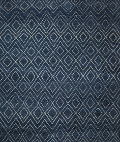 This Hand-knotted rug displays a double diamond Moroccan pattern in subtle, natural tones. Thick, fine wool yarns in navy blue with ivory color diamonds that lend an ultra-plush feel and variegated shading that is unique to the rug.   Our rugs are artisan crafted and no two are alike. Given their handwoven nature, slight variations in shading and size are inherent to the each rug. Pile height is