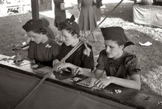 """November 1938. """"Women playing bingo, a very popular game at the state fair. Donaldsonville, Louisiana."""" View full size. 35mm negative by Russell Lee."""