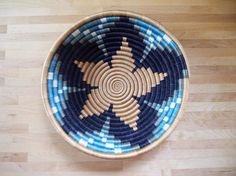 This sisal, woven basket is approximately 12 in diameter and 100% handmade by our artisans in Gitarama, Rwanda. The women grow their own sisal