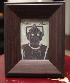 Art for the robot bathroom?  Doctor Who Cyberman mini portrait & tabletop frame - geekery - sci-fi - nerd - Dr. Who - Cybermen. $15.00, via Etsy.