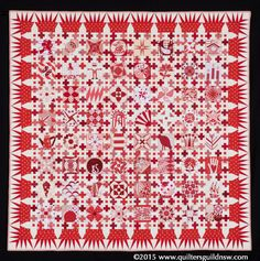Wingdings: A Variety of Symbols by Lorena Uriate  (Quilted by Michele Turner, Pinetree Cottage Quilting). Block  Designs by Chuck Nohara.  1st prize, Red and White, Commercially Quilted. 2015 Sydney Quilt Show.