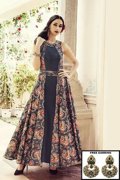 Featuring a contemporary cut, this black Ready made salwar kameez Mumbai - Designer salwar kameez online Mumbai - Anarkali Suits Mumbai. comes in a plain art silk fabric with a printed jacket style drape that falls on the sides with a grace. Neck is an elaborate work using big stones and chain work resembling a necklace; belt at the waist being a printed sash with a stone and leather adornment. The length going a long 56 inches, this is a remarkable ensemble that makes you stand class apart…