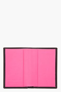 "COMME DES GARÇONS WALLETS //  Black and pink patent Card Holder  31230M005001  Patent leather card holder in black. Document pocket and two card slots at interior. Fully lined in neon pink leather. Tonal stitching. Approx. 4"" length, .5"" width, 2.75"" depth. 100% leather. Made in Spain.  $135 CAD"