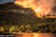 Wildfires Update: Heartbreaking photo from Lake Lure - the familiar view from the beach. Chimney Rock Village evacuating now. 20+ fires are burning in western NC, 20,000+ acres. THANK YOU to 600+ firefighters from 40 states. Biggest fires are southwest near Franklin, Nantahala Gorge & Robbinsville. No fires in Asheville or near Biltmore, just some smoke. Many parks closed, including Chimney Rock. Get full update at www.romanticasheville.com/forest-fire. Via @asheville #SETourism