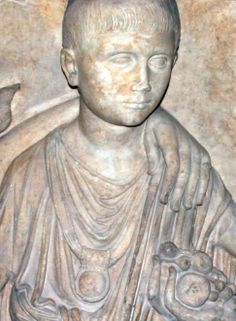 Detail of a child's tomb monument showing an ancient Roman boy wearing a bulla, the amulet thought to protect a freeborn boy from malevolent supernatural influences and marked him as sexually unavailable