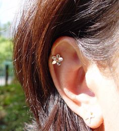 Want! :) Helix Plumeria Flower Earring - Sterling silver and Bronze
