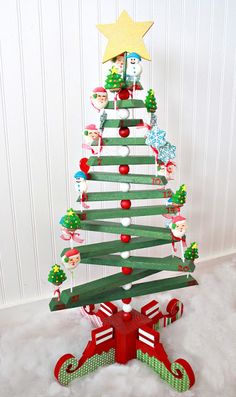 Crafty Sisters...I love the base of this tree....it has Elf-Shoe shaped wood for the Stand...