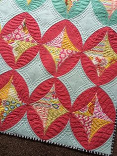 "Quilting that looks like toes on lower left block. Would be awesome on a ""Monster"" quilt for a little boy."