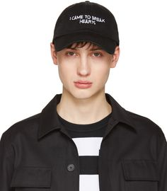 Cotton canvas cap in black. Text embroidered in white at face. Curved brim. Eyelet vents at crown. Graphic embroidered in white at back face. Cinch strap fastening. Tonal stitching.