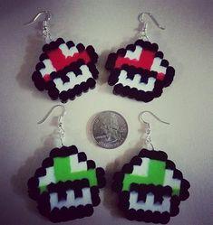 Show your gamer love with these adorable Mario Mushroom earrings! #mario #supermario #gamer #gamergirl #gamergifts #videogames #retro #mushrooms #mariomushroom #jewelry #earrings #perler #perlerbeads #8bit #pixel #pixelart #handmade #crafts #marshallarts #perlerbeadjewelry #nintendo #nes #snes #arcade