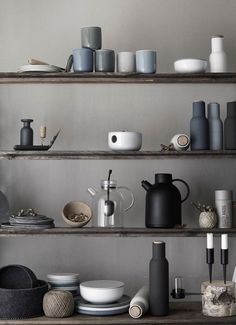Grey and white palette with a touch of blue grey.  The smoothness of the ceramics is reminiscent of a pebble, washed over by thousands of waves.