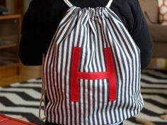 This DIY drawstring backpack makes the perfect sized backpack for a toddler, or a small daypack for an older kid that they can use to hold ballet gear, shoes, or their lunches.