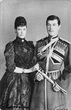 Maria Feodorovna, Empress of Russia (1847-1928) with her eldest son Tsesarevich Nicholas (1868-1918), later Nicholas II. The photograph is signed 'Maria' and 'Nicky'.