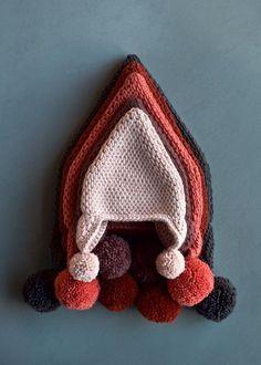 Tunisian Crochet Pointy Pom Pom Hat - free pattern in baby-adult sizes from Purl Soho/Purl Bee. ༺✿Teresa Restegui http://www.pinterest.com/teretegui/✿༻