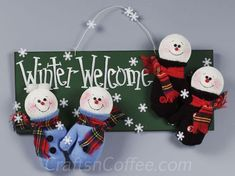 DIY Little Mitten Snowmen Winter Welcome Sign: You could also make ornaments from the mitten snowmen. Cute!