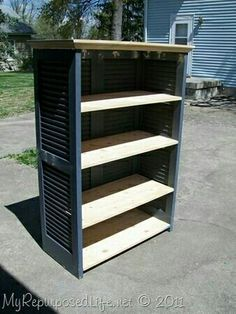 Bookshelf using shutters/closet doors and 5 easily made wood shelves.