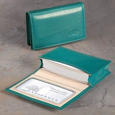This leather business card holder is teal simple  This leather business card wallet can hold up to 50 business cards. You can also use this business card holder as a leather wallet to carry up to 20 plastic cards, plus your ID.
