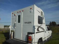 2016 New Travel Lite Rayzr F K Front Kitchen Truck Camper in Michigan MI.Recreational Vehicle, rv, 2016 Travel Lite Rayzr F K Front Kitchen, 2016 TRAVEL LITE RAYZR' FK ' FrontKitchen, Upgrades - 5,000 BTU Side Mount Air Conditoner , Fantastic Roof Vent 12v , CD/AM/FM/MP3 Stereo with Interior & Exterior Speakers , Standard Features : One-Piece Fiberglass wrapped Roof & Front , Insulated Roof, Walls & Floor , Detachable 30 amp Power Cord , 45 Amp Convertor , Upgraded…