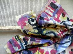 Hand painted silk scarf - 20th Century.Graffiti style. Ready to Ship    t is pure flat crepe silk hand painted scarf in blue, yellow, red, brown and black color palette. A graffiti style, modern approach to ancient petroglyphs.    The colors are fixed and permanent, the hems are hand-rolled and stitched.  It comes with a hand-made gift box, especially made to match the scarf.  Dimensions: 58 sm /58 sm (22.8 inch / 22.8 inch)