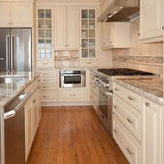 """Another beautiful photo by Kitchen Elements! Here we see Showplace's Paint Grade featuring our Covington door style finished with Linen paint and a Carmel glaze. Notice the wonderful contrasting soft cabinetry and warm hardwood flooring. The mullion doors add the perfect """"little something extra"""" for character! http://www.kitchenelements.com/ and http://www.showplacewood.com/"""