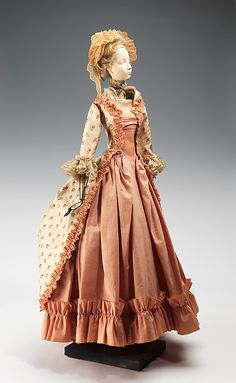 """""""1779 Doll""""  Lucille Manguin  Designer: Alex Tonio (French) Date: 1949 Culture: French Medium: metal, plaster, hair, cotton, silk Dimensions: 34 x 10 in. (86.4 x 25.4 cm) Credit Line: Brooklyn Museum Costume Collection at The Metropolitan Museum of Art, Gift of the Brooklyn Museum, 2009; Gift of Syndicat de la Couture de Paris, 1949 Accession Number: 2009.300.725a, b"""