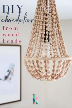 Hey there! Let me guess... you love the look of gorgeous, upscale chandeliers and light fixtures, but you don't love the price tags? Yep, I can relate. That's why I tend to make my own light fixtures, including this DIY chandelier.  Kaleidoscope Living    #diychandelier#diywoodbeadchandelier #diywoodbeadchandeliertutorial #chandelier Diy Home Decor On A Budget, Diy Home Decor Projects, Decor Ideas, Craft Ideas, Interior Decorating Styles, Decorating Blogs, Interior Design, Wood Bead Chandelier, Chandeliers