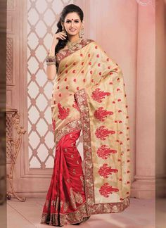This delightful diva accoutre features unique styling and unusual material. Get the simplicity and grace with this beige and red art silk and jute silk designer saree. The lovely embroidered and patch...