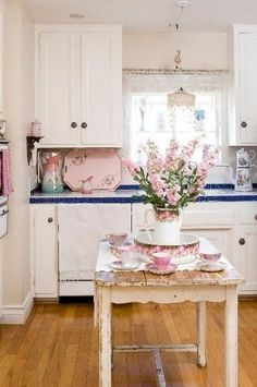 Fresh Flowers and Rustic Island for Shabby Chic Kitchen Decor.