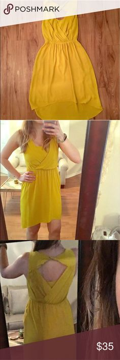 Chartreuse Yellow Cocktail Dress This is a gorgeous yellow dress that has a slip underneath and a peep hole in the back. It is in perfect condition but I am selling it because it is too tight in my bust I am a 34C. Originally $80 Express Dresses Midi