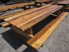 Rough Sawn picnic table with attached benches.