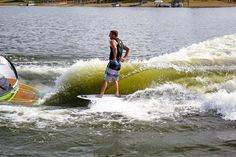 Shawn Watson wakesurfing behind a Nautique G23 with SeaDek