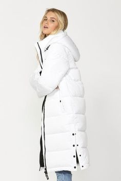 Rug up, zip up and step out in this luxurious puffer designed for warm feels. Its long-line silhouette hits just above the knee and includes features like a cosy high neckline, press-stud pockets, a secure zip pocket and detachable hood. Long A Line, Cosy, Perfect Fit, Zip Ups, Feels, Winter Jackets, Neckline, Rug, Silhouette