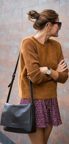 camel wool sweater, mini skirt and black leather handbag