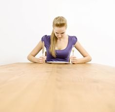 Woman sitting at table, looking at empty