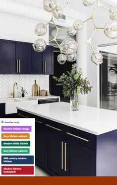 White Kitchen With Navy Blue Island A Pair Of Clear Glass Light