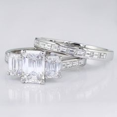 We recently finished this Stunning 3-Stone Emerald Cut Diamond Engagement Ring and Wedding Band Set accented perfectly matched channel-set baguettes.