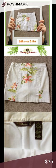 Tommy Bahama Hibiscus Skort White on White Embossed Palm Pattern with Hibiscus Flowers in several shades of Coral and green leaves. Side hidden zipper. Welt pocket in back with 2 back vents. Attached shorts. It was bought at a golf shop but pretty enough to wear as a skirt shopping or luncheon date. 62% Cotton 35% Silk 3% Spandex. Tommy Bahama Skirts