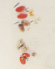 Take shells and paint them then pair them up with little colored toothpicks between them. Non-cheesy butterfly art.