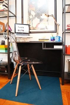 Hang a black drop cloth behind your desk to hide a tangled mass of wires. | 36 Genius Ways To Hide The Eyesores In Your Home