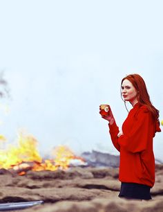 Amy Pond cannot be bothered by that volcano fire while she drinks her latte.