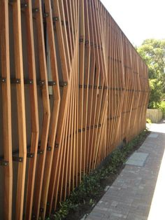 Love this… Vertical timber slats to dress a block wall… Plays tricks on the eyes too!