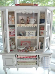 This charming 1:12 scale cottage styled kitchen hutch comes with everything shown. This is such a pretty piece and will not be made again. It