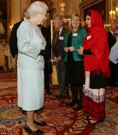 Malala told the Queen, 'It is a great honour for me to be here' during the reception at Buckingham Palace