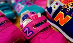 File photo of sneakers for children of U.S. manufacturer New Balance are on display at a children clothing shop in Hanau near FrankfurtSneakers for children of U.S. manufacturer New Balance are on display at a children clothing shop in Hanau near Frankfurt, Germany, March 18, 2016. REUTERS/Kai Pfaffenbach/File Photo