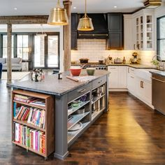 most perfect kitchen i've ever seen. EVER. rustic exposed beams, 3 tone cabintery, gold fixtures, farmhouse sink., subway tile. #amazing #duplicatingthissomeday
