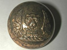 Antique Button (cat head atop a crown flanked by wings)