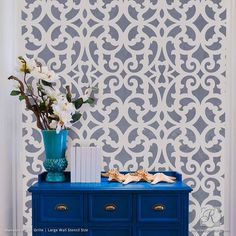 Trendy designer trellis wall stencils that mimic a wallpaper look on a large accent wall in your home. Paint these patterns in any space that needs wall art!
