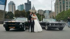 Mustangs in Black 1966 Shelby GT350 and 1967 GT Convertible Ford Mustangs outside Melbourne Museum for Ammar and Dalal's wedding shoot.