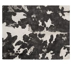 Cow Printed Rug | Pottery Barn  This is bold, but fun.